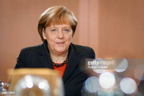 German Chancellor Angela Merkel arrives for the weekly cabinet meeting at the chancellery on October 19 2014 in Berlin Germany