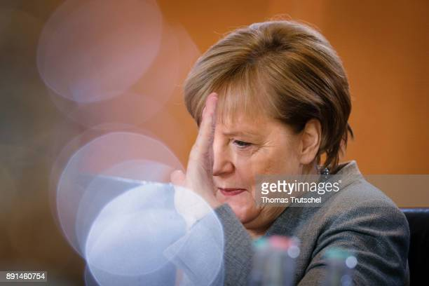 German Chancellor Angela Merkel arrives for the weekly cabinet meeting at the chancellery on December 13 2017 in Berlin Germany