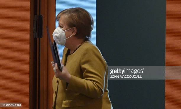German Chancellor Angela Merkel arrives for the weekly cabinet meeting on April 13, 2021 at the Chancellery in Berlin.