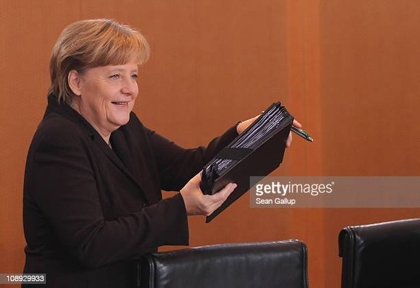 German Chancellor Angela Merkel arrives for the weekly German government cabinet meeting at the Chancellery on February 9 2011 in Berlin Germany...