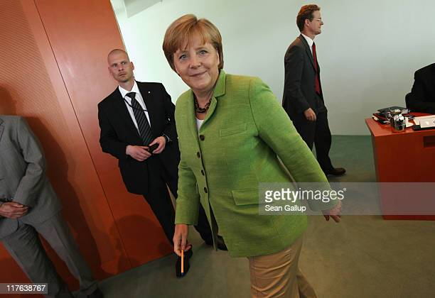 German Chancellor Angela Merkel arrives for the weekly German government cabinet meeting at the Chancellery on June 29 2011 in Berlin Germany High on...