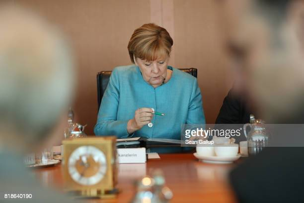 German Chancellor Angela Merkel arrives for the weekly German government cabinet meeting at the Chancellery on July 19 2017 in Berlin Germany Today's...