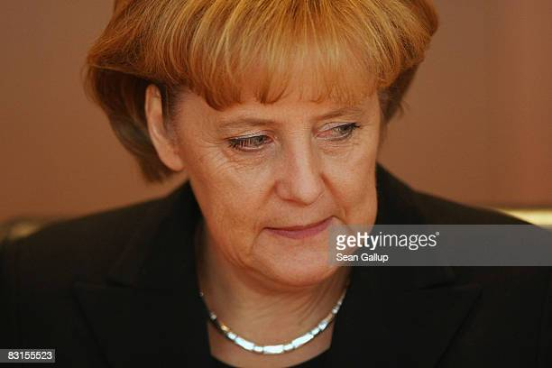 German Chancellor Angela Merkel arrives for the weekly German government cabinet meeting at the Chancellery on October 7 2008 in Berlin Germany The...