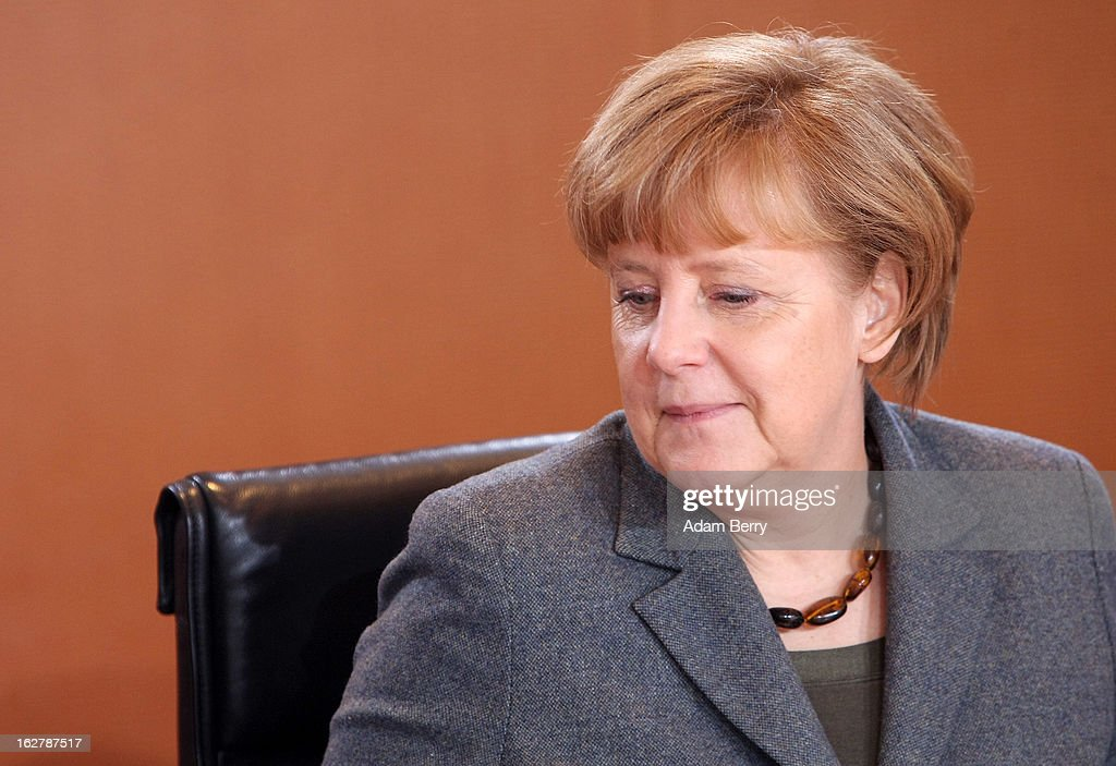 German Chancellor Angela Merkel arrives for the weekly German federal cabinet meeting on February 27, 2013 in Berlin, Germany. High on the morning's agenda was discussion of the country's annual report on disarmament as well as of potential modifications to a law on employment rights for foreigners.