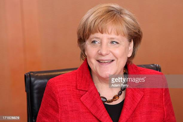 German Chancellor Angela Merkel arrives for the weekly German federal Cabinet meeting on June 26 2013 in Berlin Germany High on the morning's agenda...