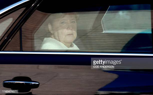 German Chancellor Angela Merkel arrives in a car to attend her conservative Christian Democratic Union party's leadership meeting at the CDU...