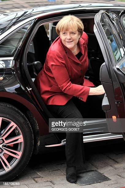 German Chancellor Angela Merkel arrives on October 24 2013 to attend a European Council meeting at the EU headquarters in Brussels European Union...