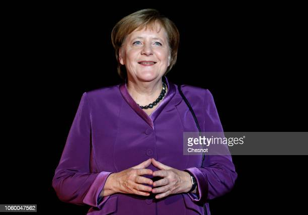 German Chancellor Angela Merkel arrives to attend a dinner hosted by French President Emmanuel Macron at the Orsay museum on November 10 2018 in...