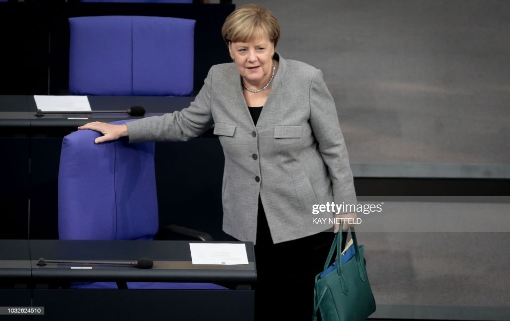 German Chancellor Angela Merkel arrives to attend a sitting of the Bundestag, Germany's lower house of parliament, on the 2019 federal state budget in Berlin on September 13, 2018. (Photo by Kay Nietfeld / dpa / AFP) / Germany OUT