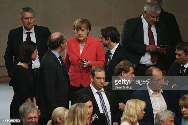 German Chancellor Angela Merkel arrives to cast her ballot during votes over the third EU financial aid package to Greece at an extraordinary session...