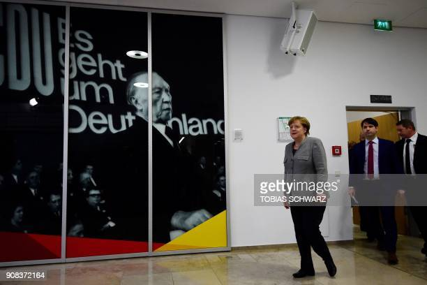 German chancellor Angela Merkel arrives to give a press conference at the headquarters of her Christian Democratic Party in Berlin on January 21 2018...