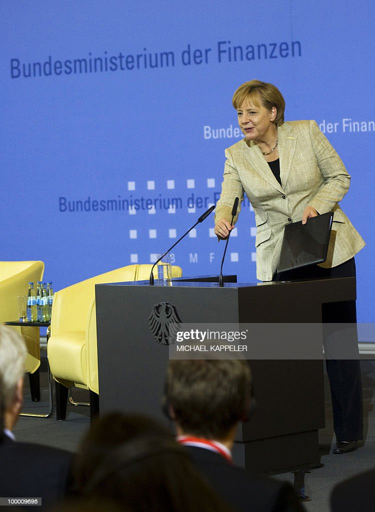 German Chancellor Angela Merkel arrives to give a speech during a conference on financial regulation on May 20, 2010 at the Finance Ministry in Berlin. Merkel said she would lead a campaign for a tax on financial markets at the next meeting of the Group of 20 developed economies in June 2010 and called for international support.