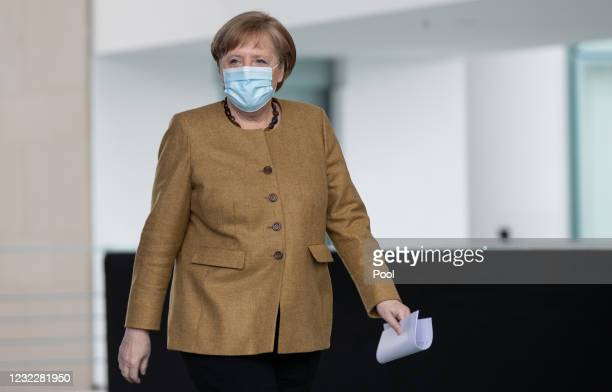 German Chancellor Angela Merkel arrives to gives a statement on the latest coronavirus measures after a Cabinet Meeting on April 13, 2021 in Berlin,...