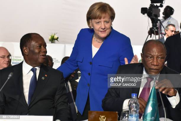 German Chancellor Angela Merkel arrives to greet Ivory Coast's President Alassane Ouattara and Guinea's President and African Union chairman Alpha...