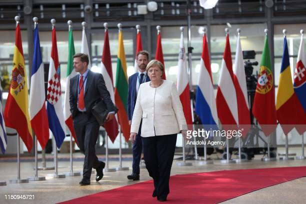German Chancellor Angela Merkel arrives to hold a press conference within European Union leaders summit in Brussels Belgium on June 20 2019
