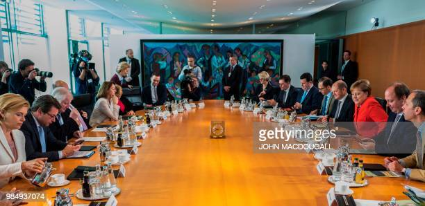 German Chancellor Angela Merkel arrives to lead the weekly cabinet meeting in Berlin on June 27 2018