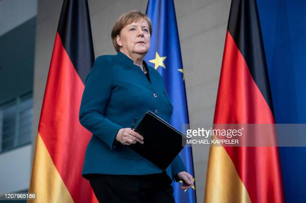 German Chancellor Angela Merkel arrives to make a press statement on the spread of the new coronavirus COVID-19 at the Chancellery, in Berlin on...