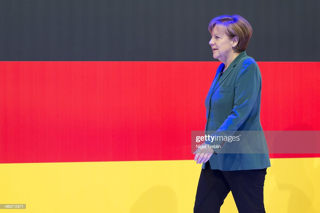 German Chancellor Angela Merkel arrives to open The Hannover Messe industrial trade fair on April 7, 2014 in Hanover, Germany. The Netherlands is the official partner Country of this year's fair with more than 5000 companies showcasing their latest industrial products and solutions. The Hannover Fair will run from April 07-11.