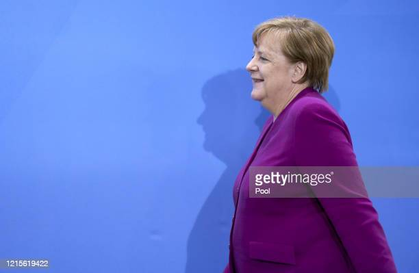 German Chancellor Angela Merkel arrives to speak to the media following a teleconferenced meeting with leaders of Germany's eastern states during the...