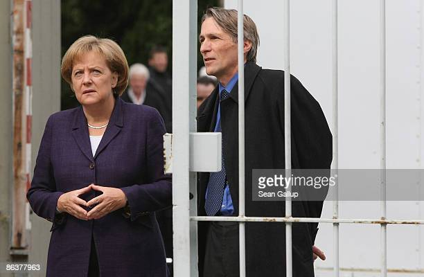 German Chancellor Angela Merkel arrives to tour the former prison of the East German communistera secret police known as the Stasi at...