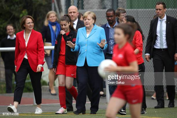 German Chancellor Angela Merkel arrives to visit a program to encourage integration of children with foreign roots through football as former...