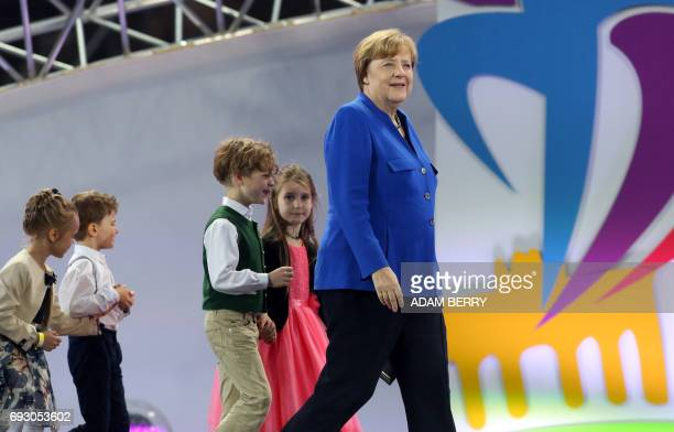 German Chancellor Angela Merkel arrives with children during the Stadium Gala of the 2017 Deutsches Turnfest at the Olympic Stadium in Berlin on June...