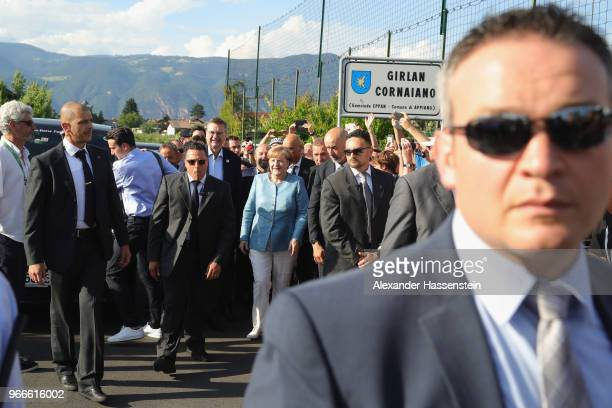 German Chancellor Angela Merkel arrives with DFB president Reinhard Grindel at the team hotel Hotel Weinegg of the German national team a during her...