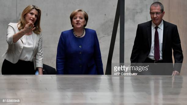 German Chancellor Angela Merkel arrives with journalists Tina Hassel and Thomas Baumann before the recording of the traditional summer interview with...