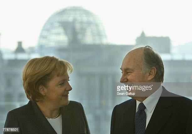 German Chancellor Angela Merkel arrives with SAS Prince Karim Aga Khan IV to meet with the press November 13 2007 in Berlin Germany 2007 marks the...