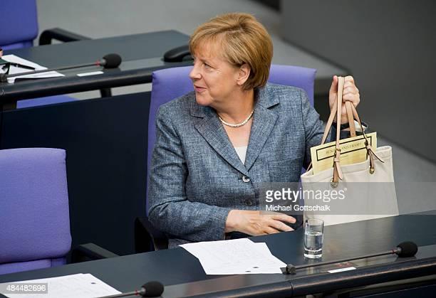 German Chancellor Angela Merkel attend the debate on financial aid for Greece in German Bundestag on August 19, 2015 in Berlin, Germany.
