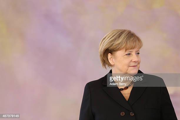 German Chancellor Angela Merkel attends a ceremony in which German President Joachim Gauck appointed the new German government cabinet on December...