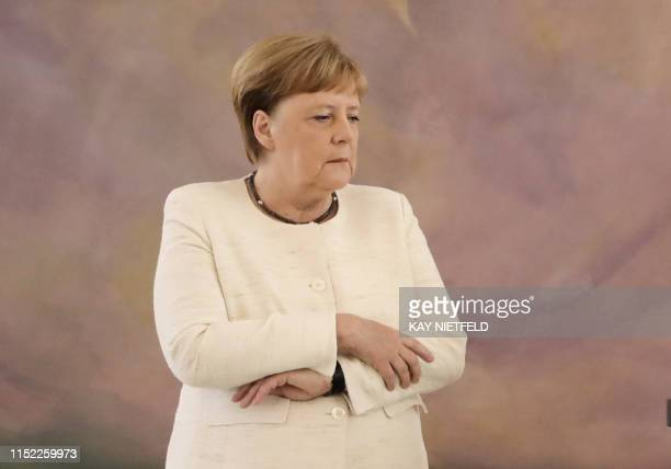 TOPSHOT German Chancellor Angela Merkel attends a ceremony where the country's new Justice Minister was given her certificate of appointment by the...