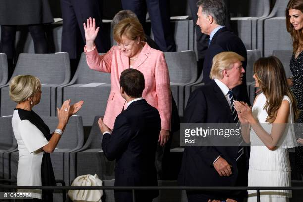 German Chancellor Angela Merkel attends a concert with French President Emmanuel Macron his wife Brigitte Macron US President Donald Trump his wife...
