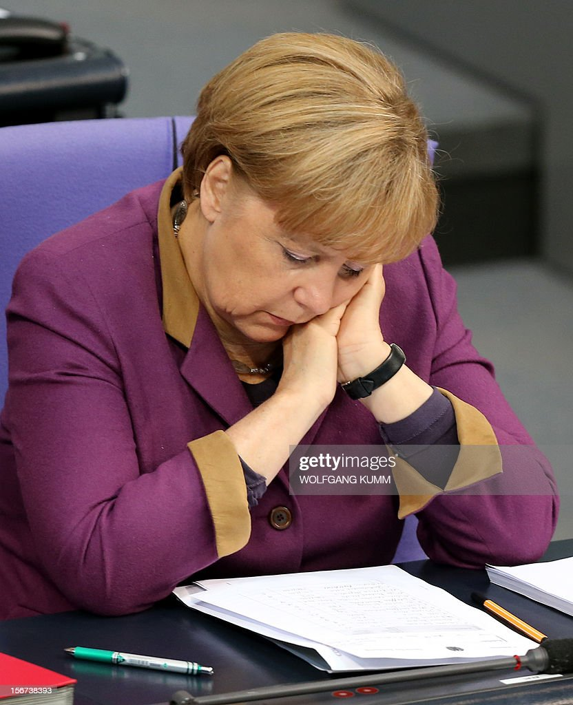 German Chancellor Angela Merkel attends a debate on November 20, 2012 in Bundestag in Berlin. Gloomy German companies are preparing to slash their workforces next year as the eurozone crisis bites, a survey showed on Monday, with more than one in four firms saying they would cut jobs in 2013. AFP PHOTO/ Wolfgang Kumm/ GERMANY OUT