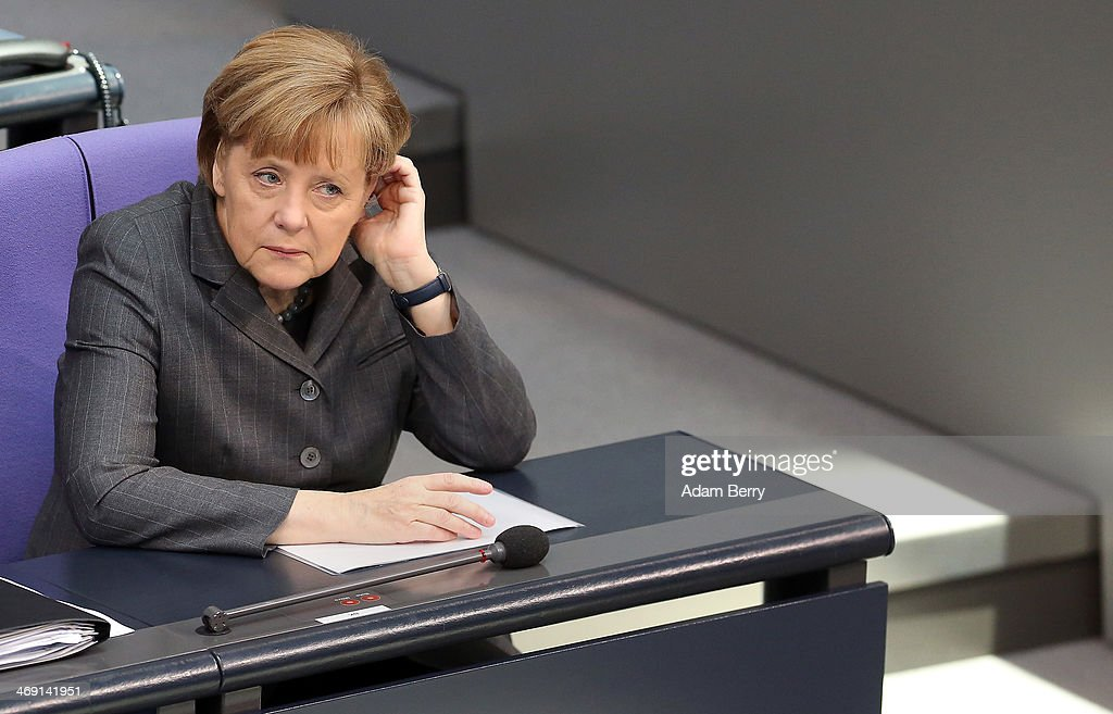 German Chancellor Angela Merkel attends a meeting of the Bundestag, or German federal Parliament, on February 13, 2014 in Berlin, Germany. In a government policy statement, or Regierungserklaerung, Vice Chancellor and Economy and Energy Minister Sigmar Gabriel (SPD) said he wants to see more financial strengthening of German cities and local communities, as well as an 8.50 EUR an hour minimum wage, a proposal met with opposition by Sahra Wagenknecht of the Left party (Die Linken), who insisted that 10 EUR an hour is a fairer salary.