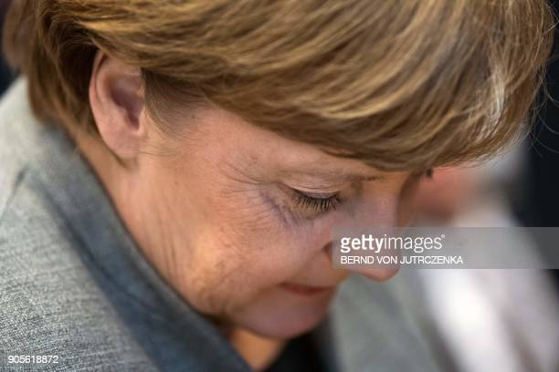 German Chancellor Angela Merkel attends a meeting of the conserviate block CDU/CSU parliamentary group at the Bundestag parliament in Berlin on...