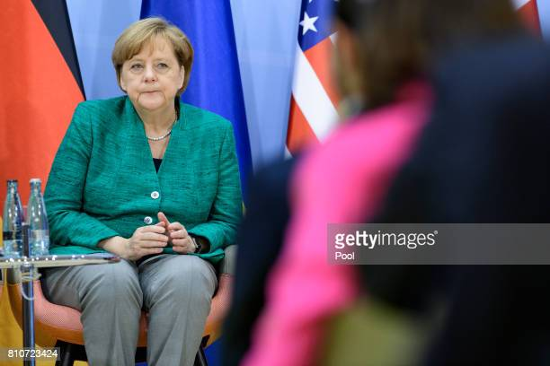 German Chancellor Angela Merkel attends a panel discussion titled 'Launch Event Women's Entrepreneur Finance Initiative' on the second day of the G20...