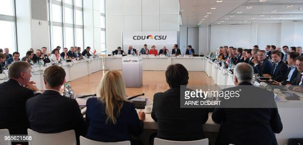 German chancellor Angela Merkel attends a parliamentary leader group conference of conservative CDU/CSU faction in the Commerzbank Tower in Frankfurt...