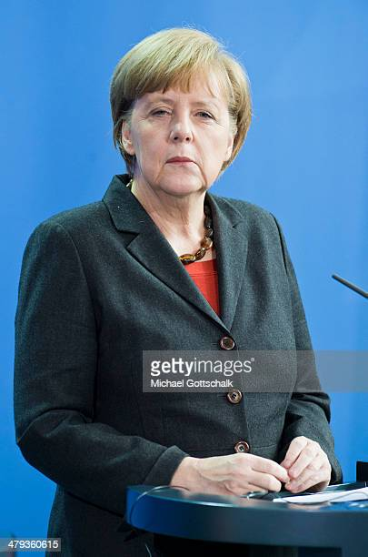 German Chancellor Angela Merkel attends a press conference on March 18 2014 in Berlin Germany After meeting with the Portuguese Prime Minister Merkel...