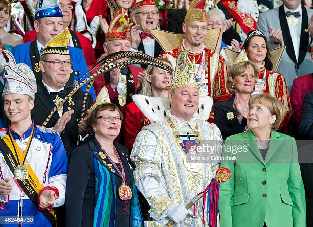 German Chancellor Angela Merkel attends a reception for members of German Carnival Clubs in the Chancellery on January 28 2015 in Berlin Germany