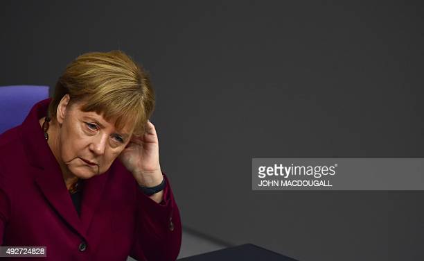 German Chancellor Angela Merkel attends a session at the Bundestag on the refugee crisis ahead of an EU summit on October 15 2015 in Berlin Merkel...
