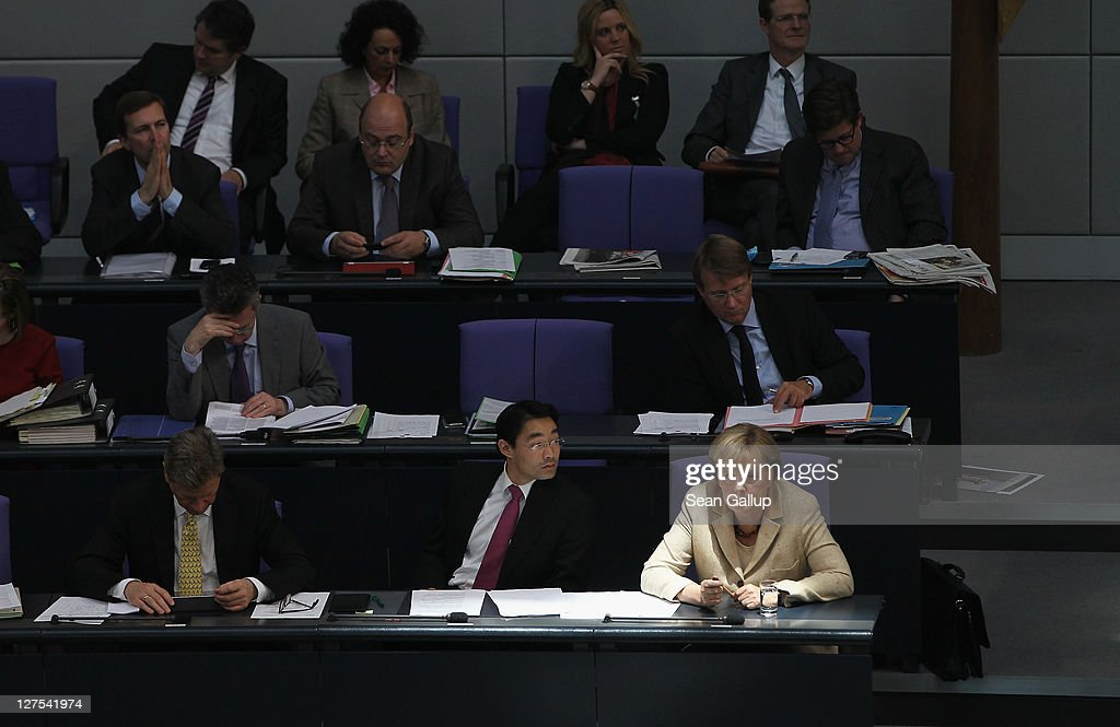 German Chancellor Angela Merkel (bottom right) attends a session of the Bundestag in which members will vote on an increase in funding for the European Financial Stability Facility (EFSF) on September 29, 2011 in Berlin, Germany. Many analysts see the increase as crucial for safeguarding the future stability of the Euro in the face of the current debt crisis in Greece. Merkel is pressing for the increase, and though opposition parties have pledged to support the bill, up to 19 dissenters within the ranks of her own coalition might vote against it.