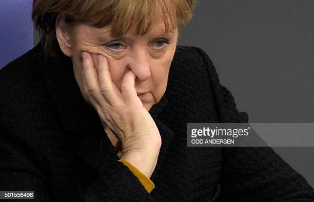 German Chancellor Angela Merkel attends a session of the Bundestag in Berlin on December 16 2015 Ahead of the EU summit in Brussels Merkel lays out...