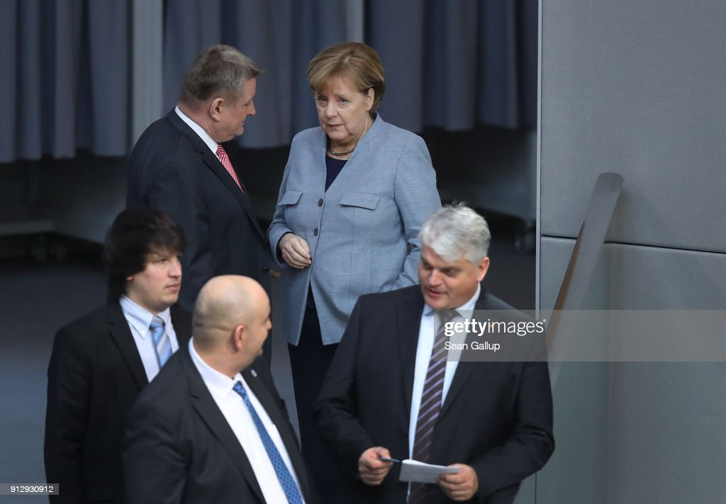 German Chancellor Angela Merkel (C) attends debates at the Bundestag over a proposal concerning the rights of refugees who have been granted limited asylum in Germany to bring into Germany members of their immediate families on February 1, 2018 in Berlin, Germany. The German Christian Democrats (CDU/CSU) and the German Social Democrats (SPD), in their ongoing coalition negotiations, agreed yesterday on a compromise that starting August 1 the number of family members allowed to immigrate will be capped at 1,000 per month.