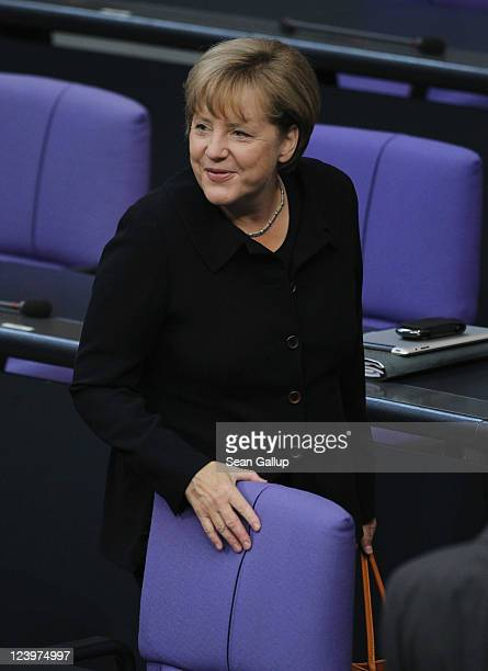 German Chancellor Angela Merkel attends debates over foreign policy during a session over the federal budget at the Bundestag on September 7 2011 in...