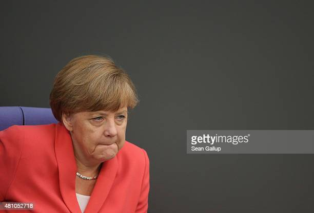 German Chancellor Angela Merkel attends debates prior to a vote over the third EU financial aid package to Greece at an extraordinary session of the...