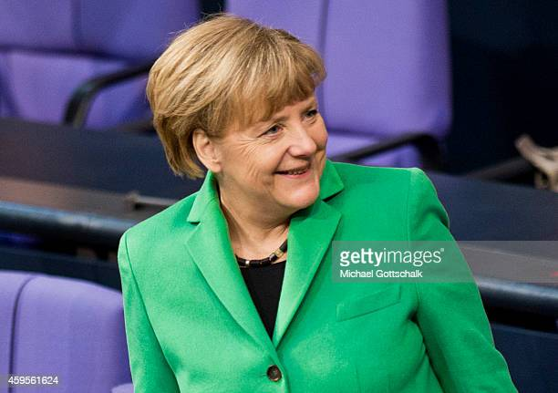 German Chancellor Angela Merkel attends the budget debate in German Bundestag on November 25 2014 in Berlin Germany German Finance Minister Wolfgang...
