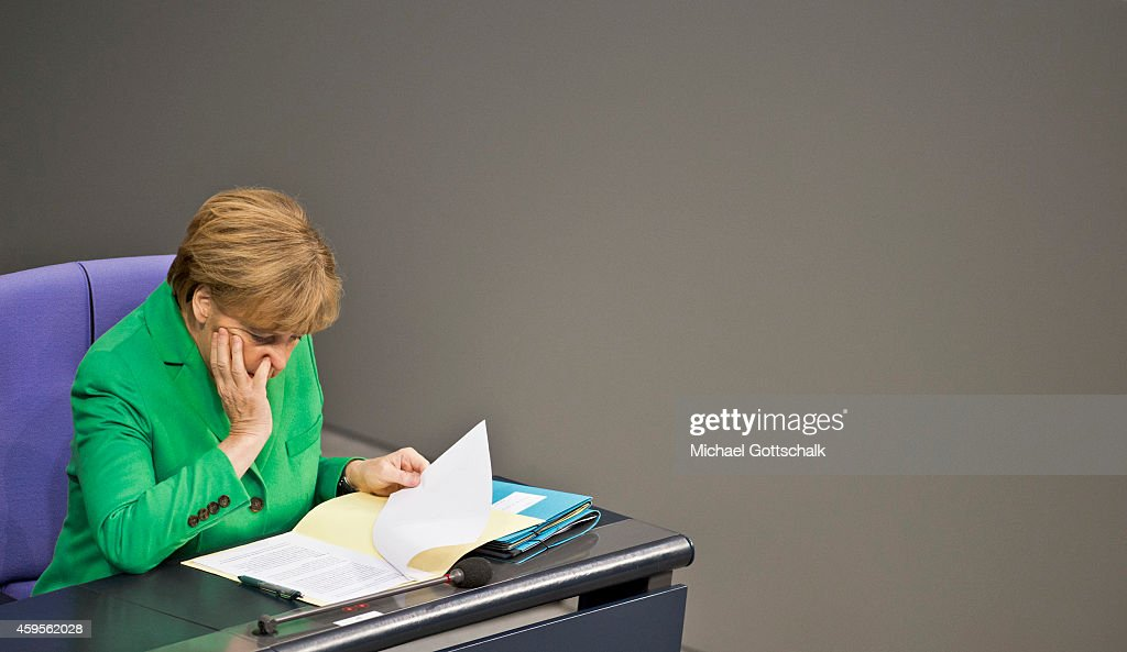German Chancellor Angela Merkel attends the budget debate in German Bundestag on November 25, 2014 in Berlin, Germany. German Finance Minister Wolfgang Schaeuble wants EU to have budget veto powers over national budgets that breach Eurozone criteria.
