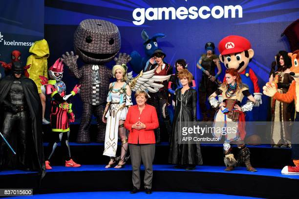 German Chancellor Angela Merkel attends the gaming fair 'gamescom' during the opening ceremony in Cologne on August 22 2017 / AFP PHOTO / PATRIK...