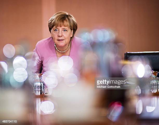 German Chancellor Angela Merkel attends the weekly cabinet meeting in the German Chancellery on August 12 2015 in Berlin Germany